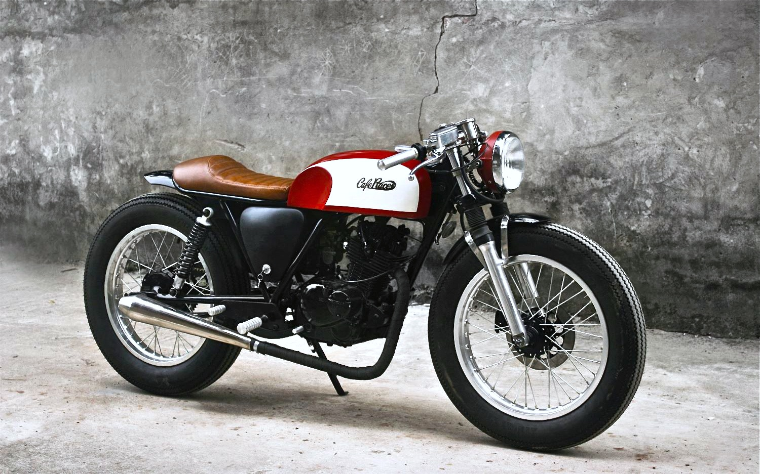 A customized Suzuki gn125 with a cafe-racer look