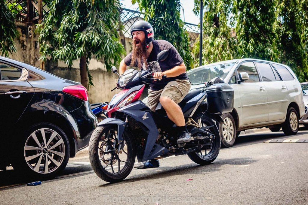 Bearded guy on a Honda Winnner