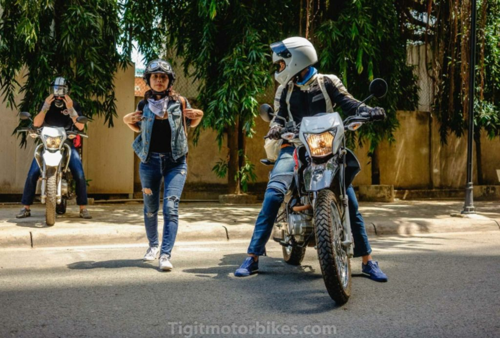 Two guys one girl motorbike cool