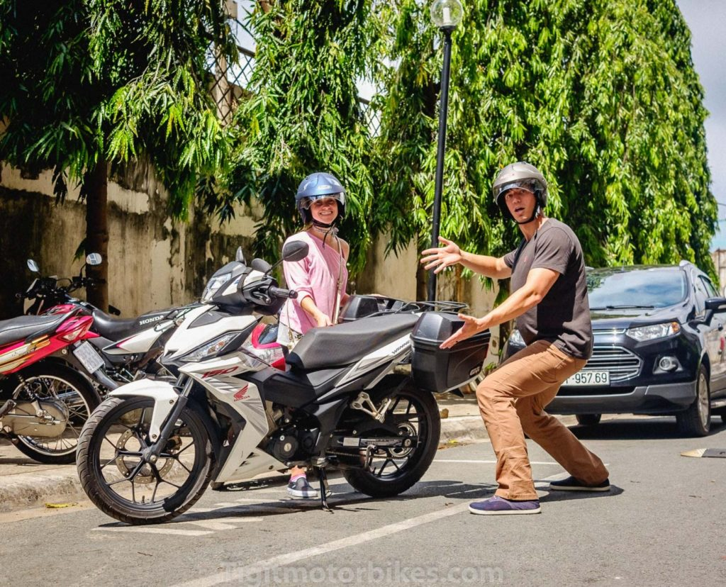 Excited Couple Renting Motorbike