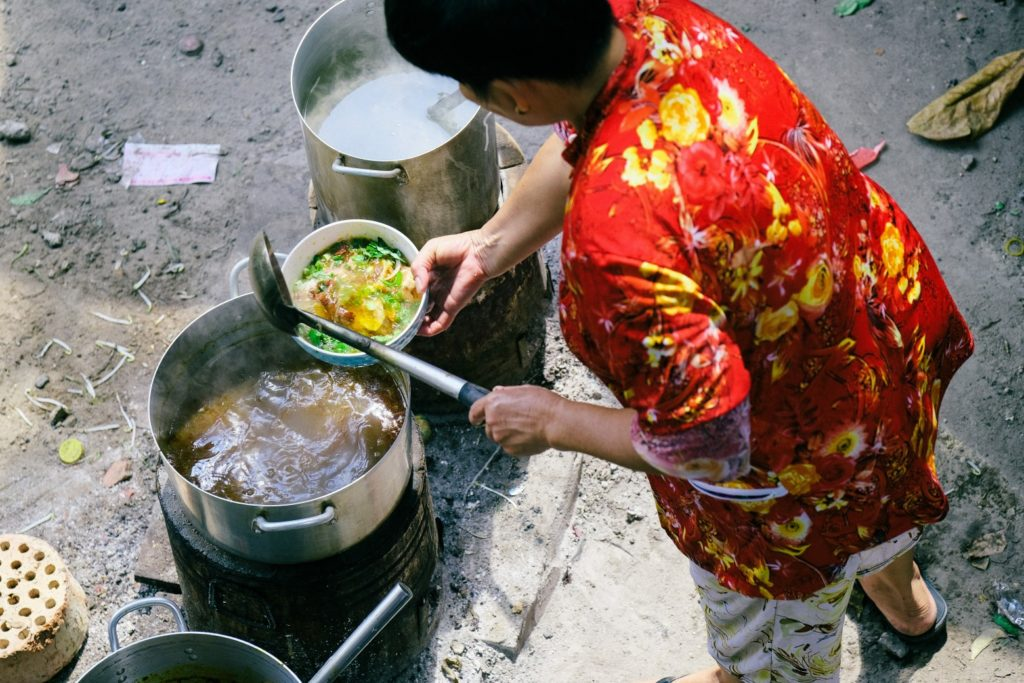 Lady Cooking Food Soup In A Pot