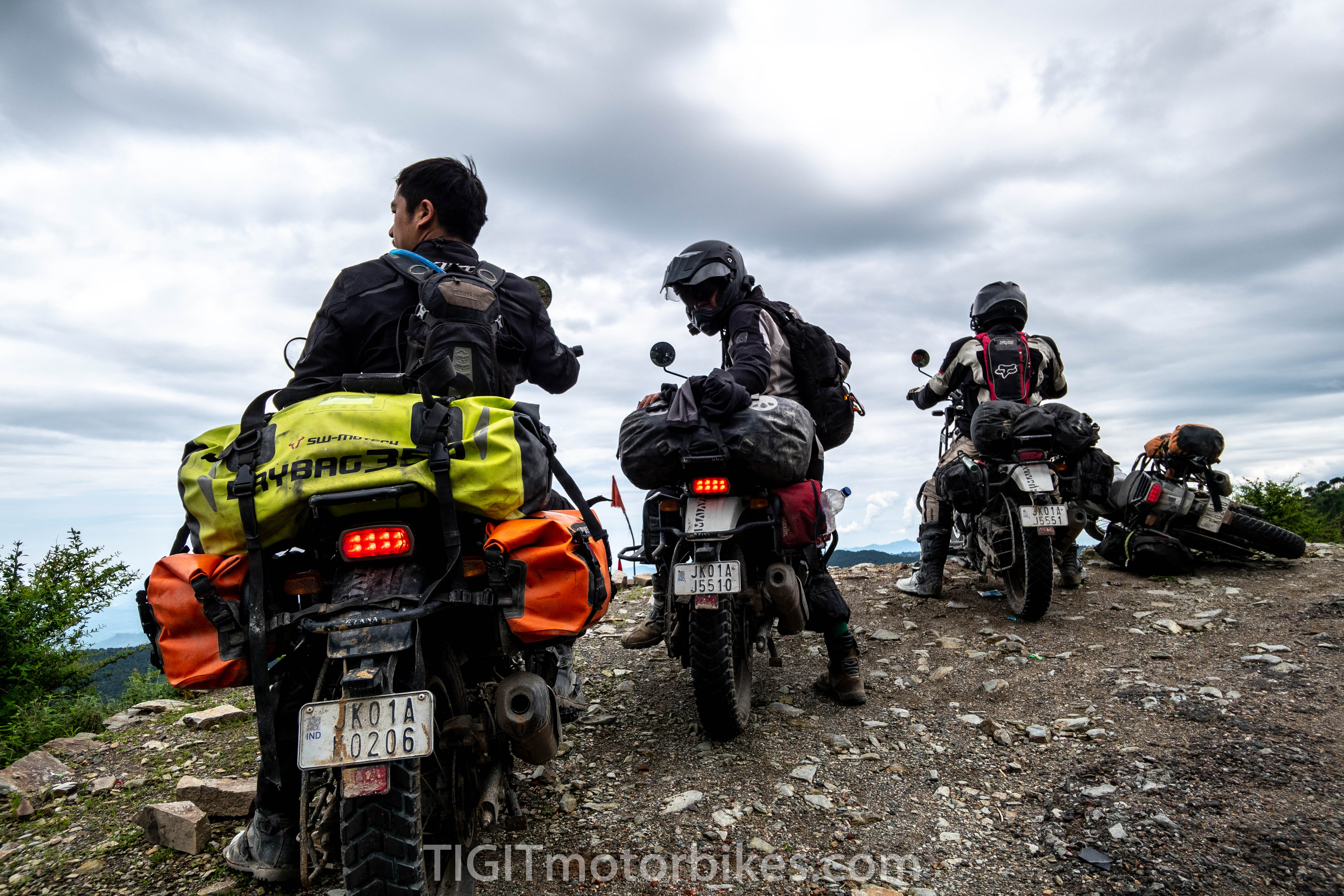 ADV riders overlooking a cliff in the Himalayas