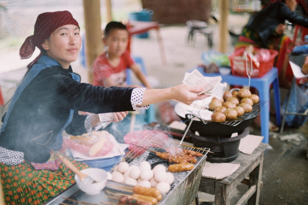 Woman serving food in the market